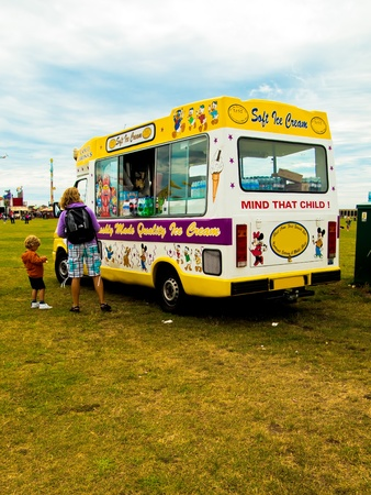 A mother and child at an ice cream van in a park, Portsmouth, England Editorial
