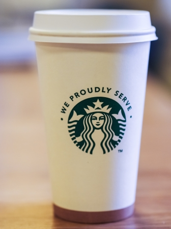A Starbucks coffee cup from a licenced vendor within the UK.