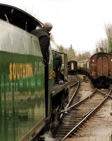 railtrack: A Southern Railways steam train, school class 4-4-0 No.925 �Cheltenham� approaching railtrack points on the Mid Hants Railway, Hampshire, England. . Editorial