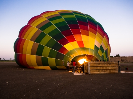 Hot Air balloon at sunrise being inflated on the west bank of the River Nile, luxor, Egypt