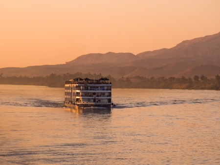 nile: A river Nile cruise boat at sunset