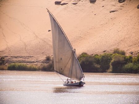 A felucca sailing on the river Nile in Egypt Editorial