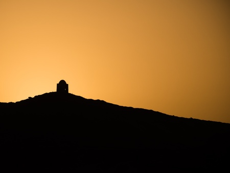 sillhouette of a Mountain and tomb at sunset on the Nile