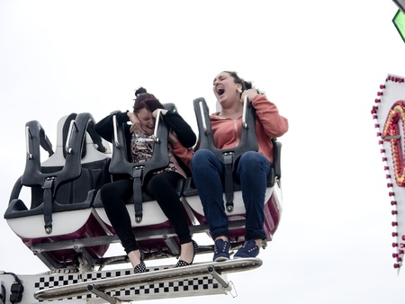 two girls on a scary funfair ride