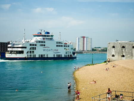A Wightlink ferry passes the hotwalls at the entrance to Portsmouth harbour