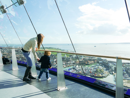 Mother and child at the top of the Spinnaker Tower in Portsmouth, Hampshire, England