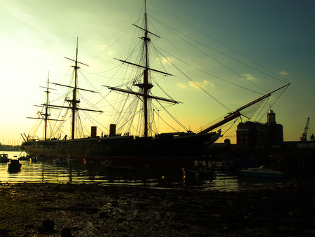 Silhouette of HMS Warrior at sunset