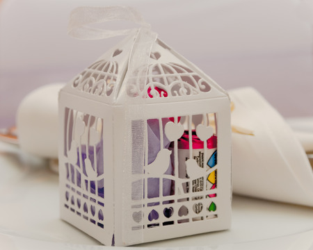 favours: A Paper cage containing wedding favours