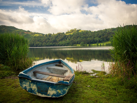 a rowing boat on the shore of Grasemere Stock Photo
