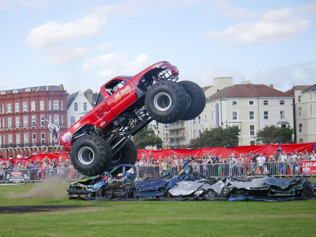 monster truck: The Lil devil monster truck driving over crushed cars at the Extreme stunt show. Editorial
