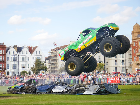 A Monster Truck jumping over a row of cars at the Extreme Stunt show