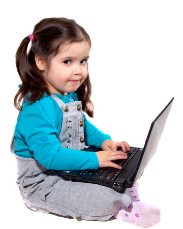 Young pre school girl using a laptop