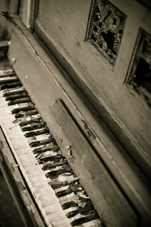 Broken old, vintage piano at the street photo