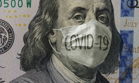 Medical mask with COVID-19 inscription on a banknote of 100 dollars, concept of the global financial crisis. Face surgical mask on american money. Coronavirus in USA. Close up, macro Reklamní fotografie