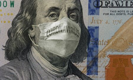Medical mask with coronavirus inscription on a banknote of 100 dollars, concept of the global financial crisis. Face surgical mask on american money. Coronavirus in USA. Close up, macro