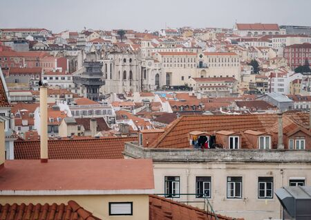 View of Santa Justa elevator and Carmo church ruins over Lisbon red tiled roofs. Portugal Reklamní fotografie