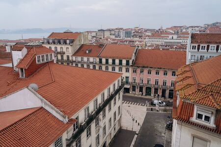 Beautiful panoramic view of Lisbon city, streets and buildings with red tiled roofs. Lisbon - Portugal