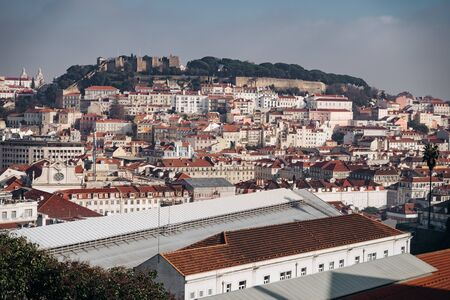 View of the Lisbon from the viewpoint Miradouro de Sao Pedro de Alcantara. Sightseeing In Portugal. Orange roofs of the old town. Travel photography. Reklamní fotografie