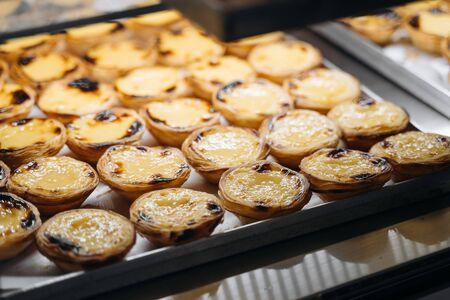 A tray with pasteis de nata, typical Portuguese egg tart pastries on a cafe showcase in Lisbon