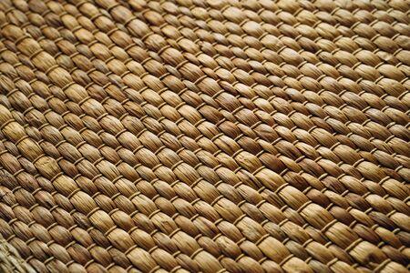 Handmade Wicker placemat made from water hyacinth. Woven mat, nature background, straw texture Reklamní fotografie
