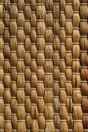 Handmade Wicker placemat made from water hyacinth. Top view, nature background, straw texture