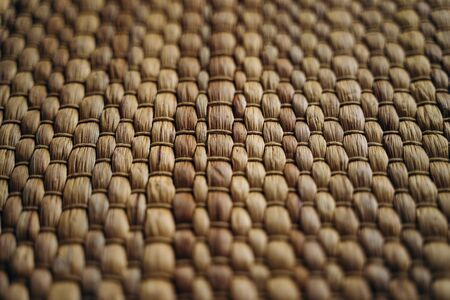 Handmade yellow wicker placemat made from water hyacinth. Woven mat, nature background, straw texture Reklamní fotografie