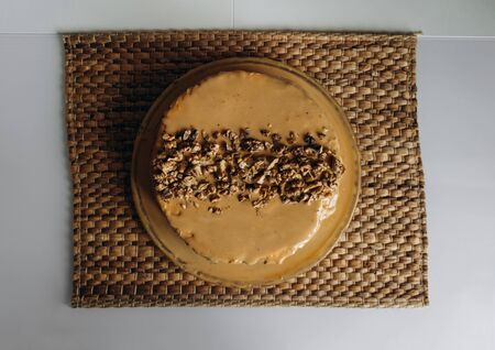 Sweet homemade honey cake with caramel and walnut nuts with kiwi and banana inside. Tasty brown cake dessert.