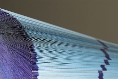 The cutting face of a phone directory with fanned pages. Stock Photo