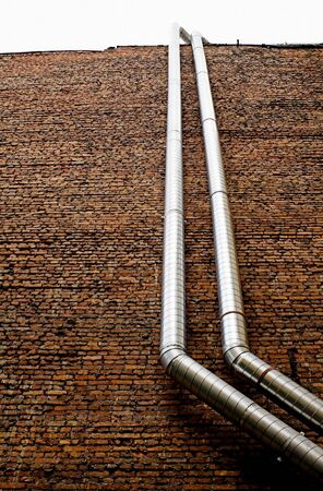 Tubes - 2 - Pipework on a brick wall. Stock Photo