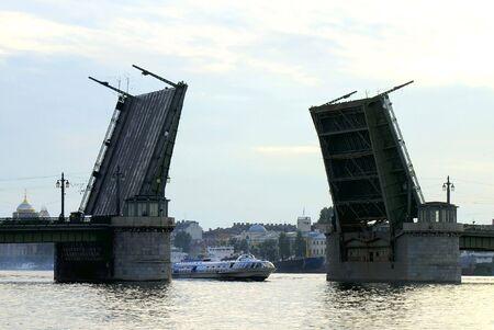 Raised Schmidts Drawbridge - 2 - over Neva river in Saint Petersburg at Dusk.