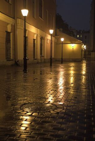 Yard - 1 - A yard with street lamps and stone pavement in Saint Petersburg at evening.