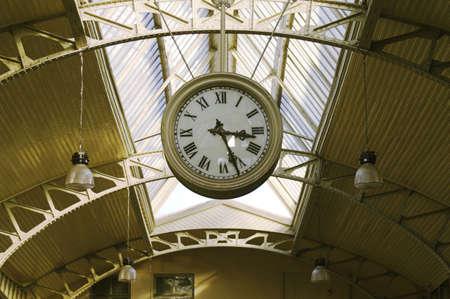 Hanging clocks - Big hanging clocks in a railroad station hall, Vitebsk Railroad Station, Saint Petersburg, Russia. photo