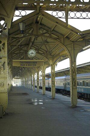 Railroad station - 5 - Railroad station platform with a hanging clock,