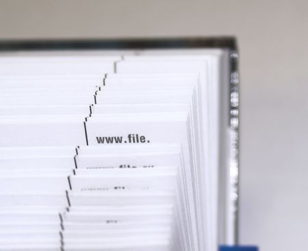 Fanned pages - The cutting face of a phone directory with fanned pages.