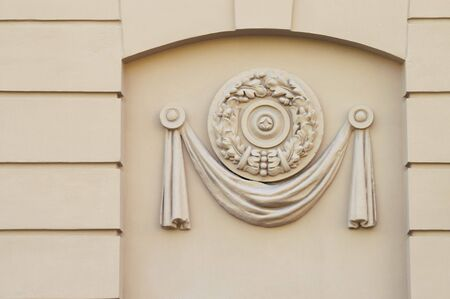 Moulded Decorative Panel - A close-up detail of a building facade decor. A moulded plastic panel. Early soviet-epoch style.