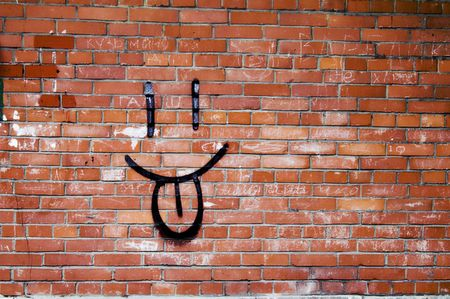 Brick Wall and Smile Graffiti - Smile Graffiti on a Red Brick Wall. Stock Photo - 2818559