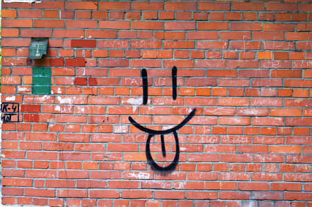 Smile Graffiti on Red Brick Wall. photo