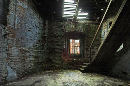 Abandoned store house hall with staircase.