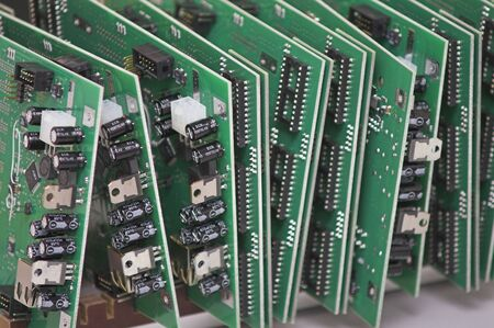 electrical component: Integrated Circuits - 3 - stacked on a table.