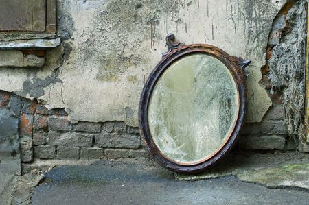 antique mirror: Old Mirror Standing Against Wall