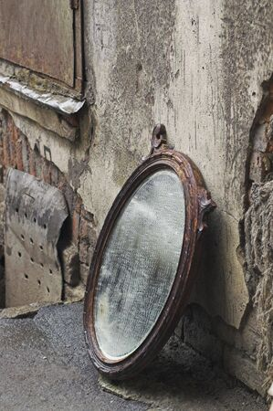 broken back: Old Mirror Standing Against Wall