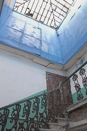 backstairs: Upper floor in old house with broken glass roof