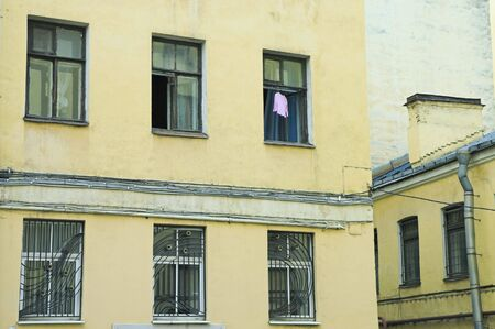 Dress hanging to dry in open window of old building Stock Photo - 2818700