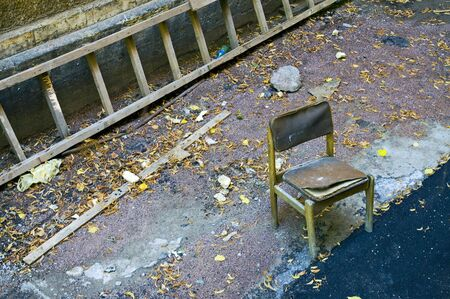 Old chair and ladder in back yard