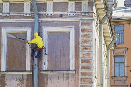 Cleaning service worker washing old building facade Stock Photo - 2818512