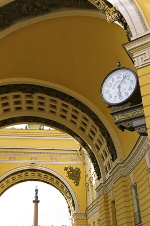 Old-style Public Clocks - 4 - under the General Army Staff Building Arch in Saint Petersburg, Russia. The inscription on the clock-face: State Chamber for Measuring and Weighing (upper, 19th century designation, now out of use) and Exact Time (bottom).