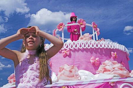 ST PETERSBURG - JUNE 28: Girl takes good look into distance at Life in Pink festival June 28, 2008 in St Petersburg, Russia.