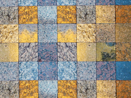 Checked pattern of various kinds of natural stone. A fragment of faced wall. Squares of grey, blue and gold for natural background. Stockfoto