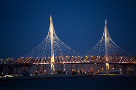 The novel cable-stayed bridge in Saint Petersburg, Russia. The bridge over the gulf of Finland near St. Petersburg stadium is part of the Western high-speed diameter highway. Night lighting. Stok Fotoğraf