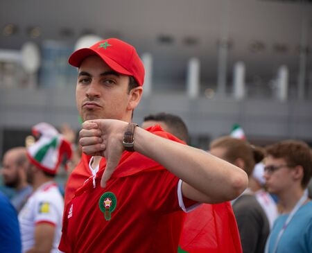 Disappointed football fan of Morocco after FIFA world cup match with Iran in St Petersburg Russia 2018 June 15. Loss 0 - 1. A man is pointing his finger down.